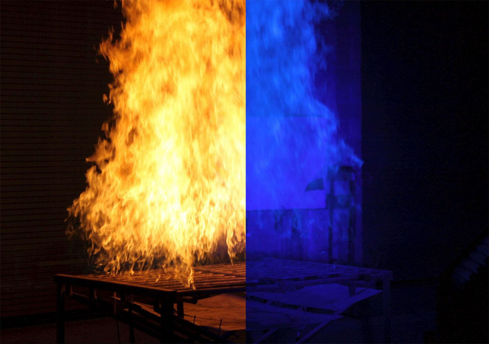 To improve the ability of researchers to 'see' through fire, NIST has developed an imaging system using ordinary blue light to dramatically clear the picture. Courtesy of National Fire Research Laboratory/NIST.