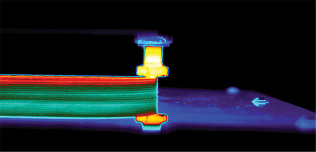 Thermal image of a carbon-based polymer additive manufacturing (AM) process. Shown is the thermal variation in the sidewall of the test piece as it is built from top to bottom.