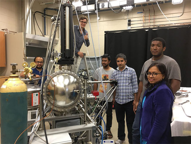 Madhab Neupane and his research team with the in-house ARPES system. From left to right: Gyanendra Dhakal (graduate student), Klauss Dimitri (undergraduate student), Md Mofazzel Hosen (graduate student), Madhab Neupane, Christopher Sims (graduate student), Firoza Kabir (graduate student). Courtesy of University of Central Florida.