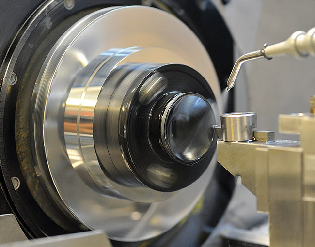 Figure 3. A BD6 chalcogenide lens undergoing precision single-point diamond turning (SPDT) processing. Courtesy of LightPath Technologies.