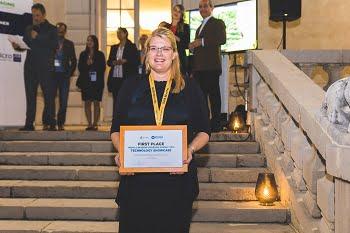 Päivi Sievilä, customer support engineer at Okmetic Oy, accepts the award for MEMS Sensors Technology. Courtesy of SEMI.