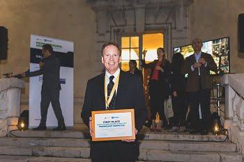 John Hubert, VP of engineering at Alertgy, holds the award for Imaging Sensors Technology. Courtesy of SEMI.
