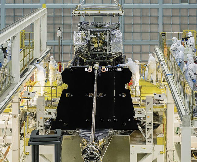 Figure 4. The James Webb Space Telescope's Integrated Science Instrument Module is lowered into the telescope, which is resting facedown on the assembly stand at NASA's Goddard Space Flight Center. Courtesy of NASA/Chris Gunn.