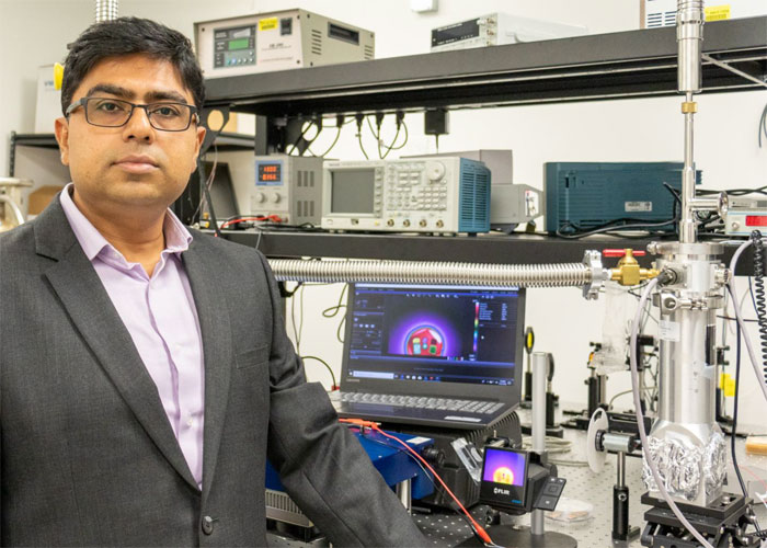 Debashis Chanda, an associate professor in the University of Central Florida's NanoScience Technology Center, demonstrates improved infrared night-vision capabilities. Courtesy of Karen Norum, University of Central Florida Office of Research.