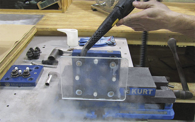 Figure 4. Debonding a workpiece from the workholding fixture with pressurized steam. Courtesy of S.I. Howard Glass Co.