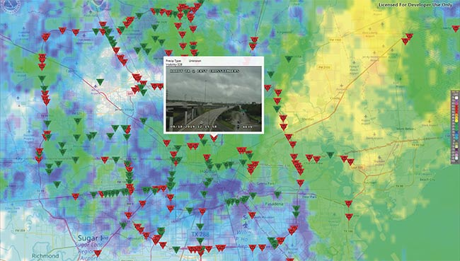 A screenshot from a demo application built around SwRI's ActiveVision showing live data from Houston at around 2 p.m. on Sept. 18, when the city was dealing with Tropical Storm Imelda. The red triangles are cameras where inclement weather was detected. The radar overlay shows that detections match live weather reports, proving that existing video/still camera infrastructure can aid traffic management by automatically spotting weather conditions and potentially other problems. Courtesy of SwRI.