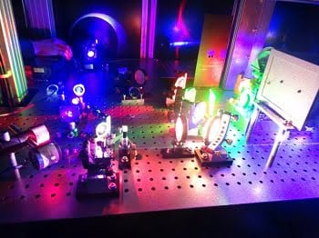 The new printer uses low-power continuous wave lasers to create holograms on a highly sensitive photomaterial developed by the researchers. Courtesy of Yves Gentet.