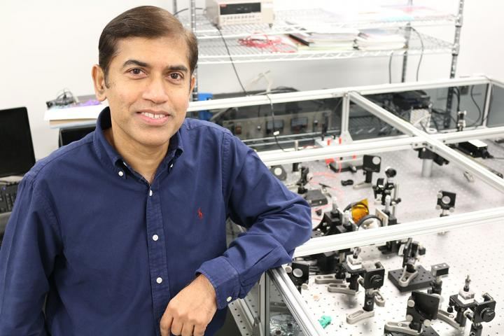UCF's Jayan Thomas led the team in reviewing more than 2000 peer-reviewed publications about perovskites and collecting more than 300 data points that were fed into the AI system the team created. The system was able to analyze the information and predict which perovskites recipe would work best. Courtesy of UCF/Karen Norum.