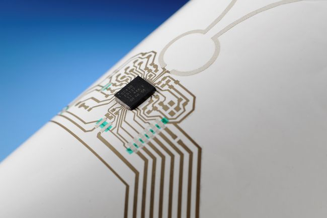 Printed and assembled electronic materials on paper substrate