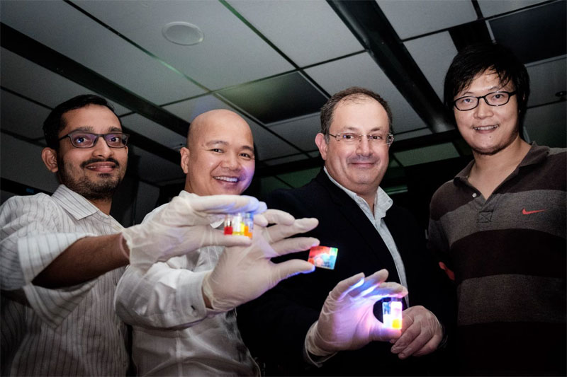 (From left) NTU research fellow Sushant Shendre, assistant professor Steve Dang, professor Hilmi Volkan Demir, and researcher Junhong Yu, holding up colloidal quantum dots that can produce laser light when powered. Courtesy of NTU Singapore.