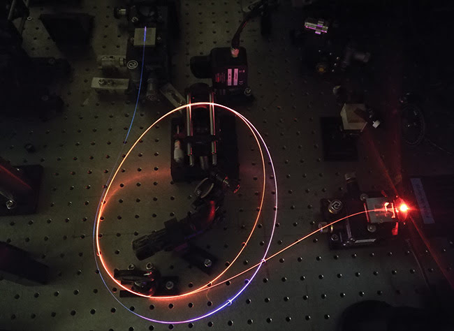 Figure 1. Antiresonant hollow-core fiber is delivering 300-fs ultrafast laser pulses with average power up to 1 W. The glowing of fiber comes from the supercontinuum generated by laser pump in the air of the hollow core. Courtesy of Heriot-Watt University.