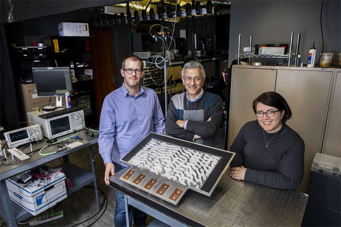 Researchers Brian Edwards, Nader H. Engheta and Nasim Mohammadi Estakhri (left to right) pose with their device. University of Pennsylvania.