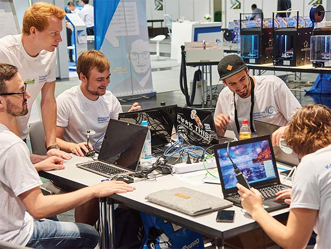 Engineers, students, and developers in the midst of the MAKEATHON, a competition that enables participants to transform their ideas into functioning prototypes for the chance to bring their products to market. Courtesy of Messe München GmbH.