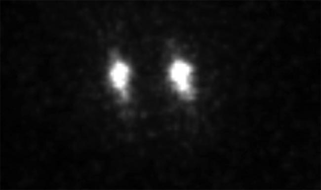 Figure 1. Individual trapped ions acquired with an electron-multiplying intensified CCD (emICCD) camera. Courtesy of Ferdinand Schmidt-Kaler, Kilian Singer, Johannes Rossnagel, and Georg Jacob/Institute of Physics, Mainz University.