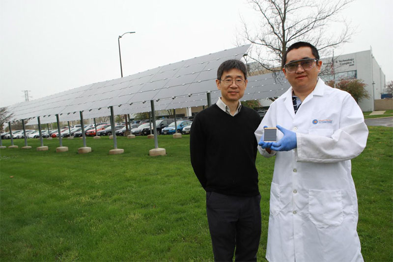 Professor Zhaoning Song holds a perovskite solar cell mini-module he developed with professor Yanfa Yan. The higher-efficiency, lower-cost solar cell technology could revolutionize the way that energy is generated. Courtesy of Daniel Miller, The University of Toledo.