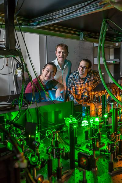 Tzu-Yung Huang, Lee Bassett and David Hopper at work in Bassett's Quantum Engineering Laboratory. Courtesy of the University of Pennsylvania.