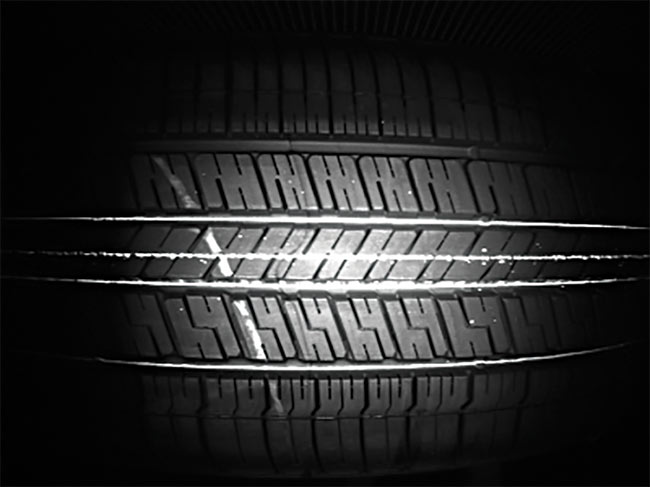 When the vision system identifies an error on a tire, such as the scratch mark shown, the tire is immediately ejected from the line. Courtesy of LEONI Engineering Products & Services Inc.