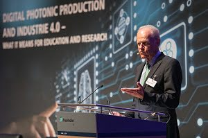 """Prof. Reinhart Poprawe welcomes the 280 guests of the symposium """"Digital Photonic Production and Industrie 4.0 and what it means for education and research."""" Courtesy of Fraunhofer ILT, Aachen, Germany, Klaus D. Wolf."""
