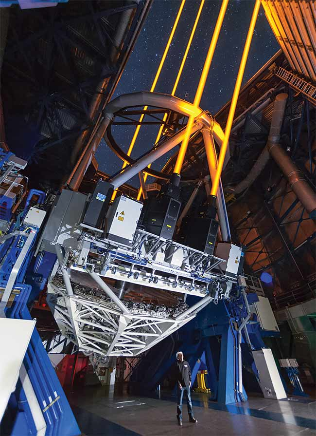 Four lasers excite sodium atoms and create artificial stars, 90 km up in the atmosphere, for the European Southern Observatory's Very Large Telescope's adaptive optics systems. Courtesy of European Southern Observatory.