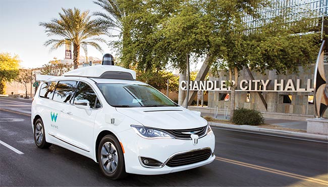 A self-driving car equipped with radar, lidar, and other sensors for navigation. Courtesy of Waymo.