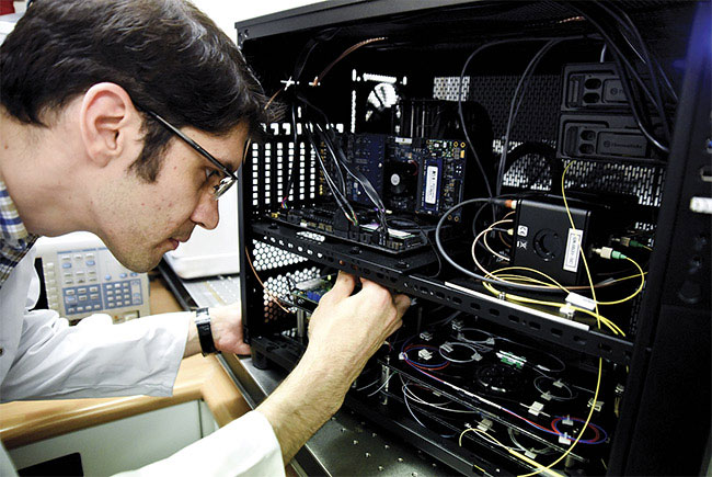 A distributed optical fiber acoustic sensing unit capable of measuring vibrations every 0.5 m along multiple kilometers of standard single-mode fiber. The strain sensitivity of this unit was measured to be 10 ne with maximum detectible strain of 1 me. Courtesy of Ali Masoudi/ University of Southampton, U.K.