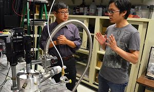 Qiang Lin, at left, assistant professor of electrical and computer engineering, and PhD student Wei Jiang, worked with researchers at the University of Victoria to show how the 'optical spring' effect could enhance the detection of single particles and molecules. (Courtesy of University of Rochester / Bob Marcotte)