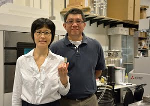 Xiayun Zhao, PhD, assistant professor of mechanical engineering and materials science, (left) and Albert To, PhD, associate professor of mechanical engineering and materials science, hold up a 3D printed turbine component in the lab. (Courtesy of University of Pittsburgh)