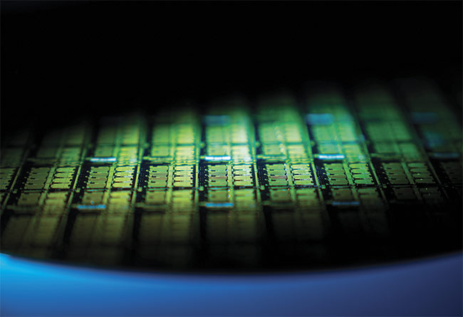 Each of the many hundreds of dies on this 300-mm wafer contains four lasers with different wavelengths, plus modulators, optical multiplexers, and photodiodes. Courtesy of Intel.