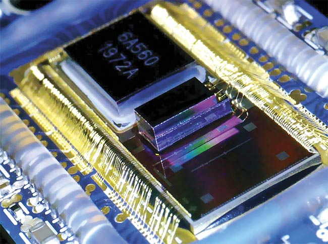 An optical transceiver built using silicon photonics. Today, these link servers together in data centers. In the future, the technology could connect chips or even sections of chips. Courtesy of Cisco.