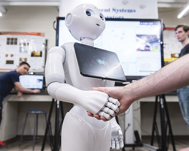 Pepper uses deep learning to articulate gestures such as a handshake. Combined with the small camera mounted on the robot's head, the software helps Pepper recognize facial expressions and estimate age and gender. Courtesy of Rensselaer Polytechnic Institute.