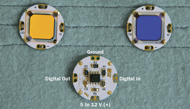 Figure 2. O-BUTTONs, front and back, with a color-tunable OLED module. Courtesy of Fraunhofer FEP.
