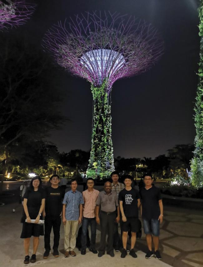 OPSS and SPIE Singapore Student Chapter members on the International Day of Light, May 16. Behind them is a 'super tree' at the Gardens by the Bay, which has a nightly light show centered around the trees.