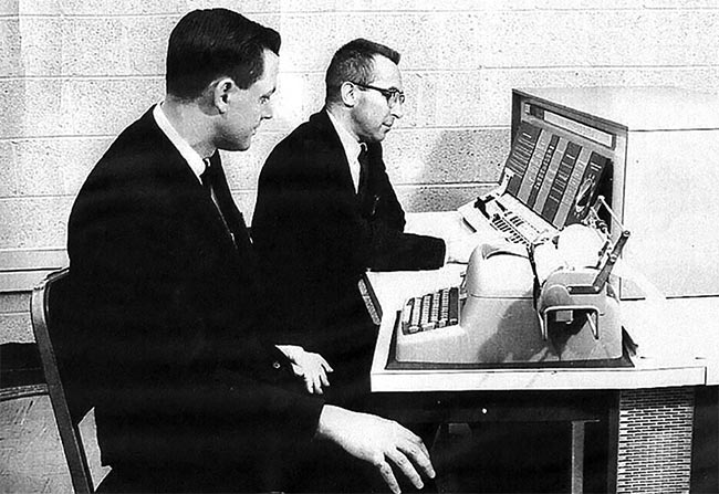 Figure 1. Don Kienholz (right) working with the author at GE's rented IBM 1620 computer in 1963. Courtesy of Bruce H. Walker.