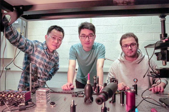 Researchers Zongfu Yu (left), Ang Chen (center), and Efram Khoram (right) developed the concept for a smart glass that recognizes images without any external power or circuits. Courtesy of Sam Million-Weaver.