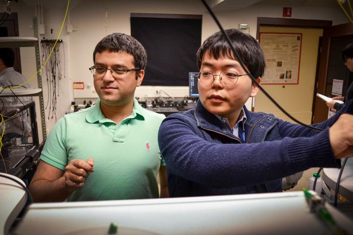Mechanical sciences engineering professor Gaurav Bahl, (l), and graduate student Seunghwi Kim confirmed that backscattered light waves can be suppressed to reduce data loss in optical communications systems. Courtesy of Julia Stackler, University of Illinois at Urbana-Champaign.