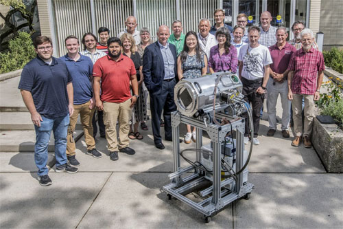 Members of the LSST project team at Brookhaven Lab are shown with a prototype raft cryostat. In addition to the rafts, Brookhaven scientists designed and built the cryostats that hold and cool the rafts to -100° Celsius. Courtesy of Brookhaven National Laboratory.
