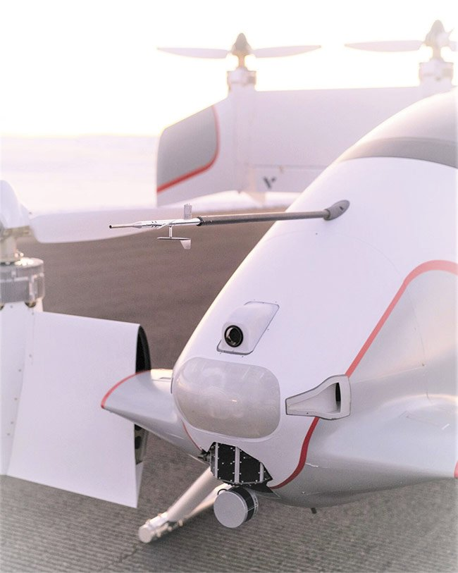 Figure 1.  The Peregrine sensing and computing payload on the Vahana includes a mechanically spinning lidar sensor from Velodyne called Puck, which verifies that landing sites are safe from obstructions and provides alternate locations if necessary. Courtesy of Vahana/Airbus Urban Mobility.