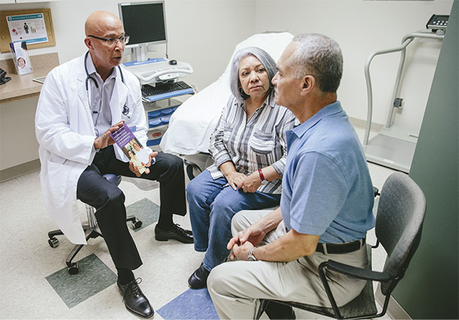 Figure 4. A couple consults with a doctor about living with symptoms of AD. Courtesy of the Alzheimer's Association.