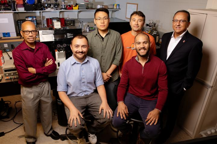 The research team includes, from (l): professor Taher Saif, graduate student Onur Aydin, graduate student Xiastian Zhang, professor Mattia Gazzola, graduate student Gelson J. Pagan-Diaz, seated, and professor and dean of the Grainger College of Engineering, Rashid Bashir. Courtesy of L. Brian Stauffer. University of Illinois/biohybrid robots propelled by muscle tissue, nerve cells.
