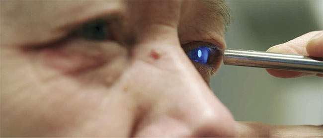 A screen grab of Dr. Joris DeLanghe using spectroscopy on a patient to diagnose and treat cataracts. Courtesy of Ocean Insight.