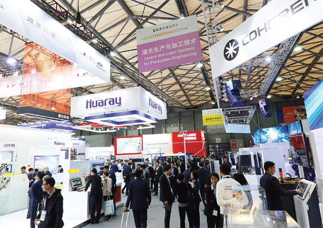 Visitors browse the exhibition hall at LASER World of PHOTONICS China. Courtesy of Messe München.