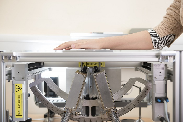 A demonstration of how the T-ray equipment can be used to scan an individual's skin. Courtesy of University of Warwick.