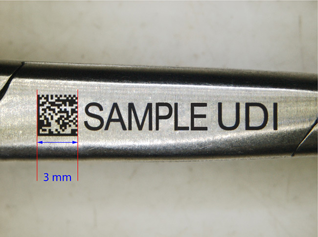 Medical UDI black marking on a stainless steel hemostatic clamp. Courtesy of SISMA SpA.