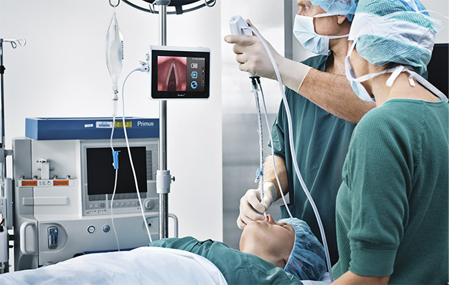 Figure 1. Doctors use an endoscope to intubate a patient. Courtesy of Ambu A/S.