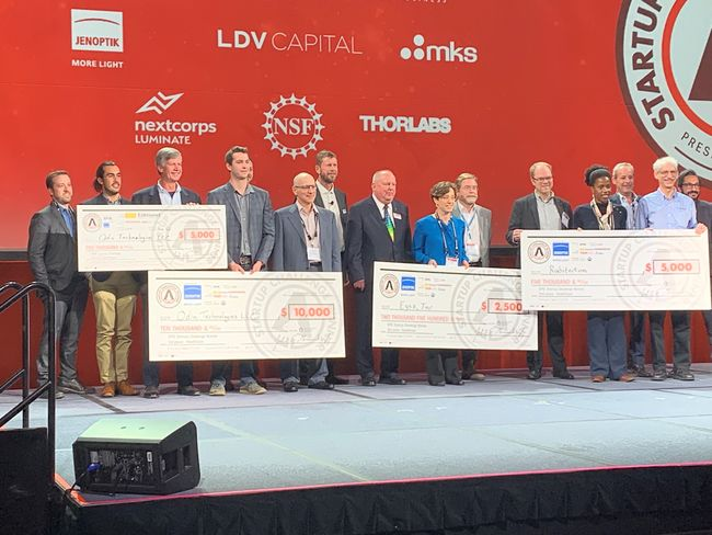 Winners pose for group photo on stage at 10th annual Photonics West Startup Challenge event. Courtesy of Photonics Media.