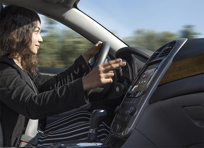 Gesture recognition inside cars, enabled by 3D sensing, could allow drivers to control equipment with the wave of a hand. VCSELs operating in the NIR offer one potential light source for 3D sensing systems. Courtsey of Lumentum.