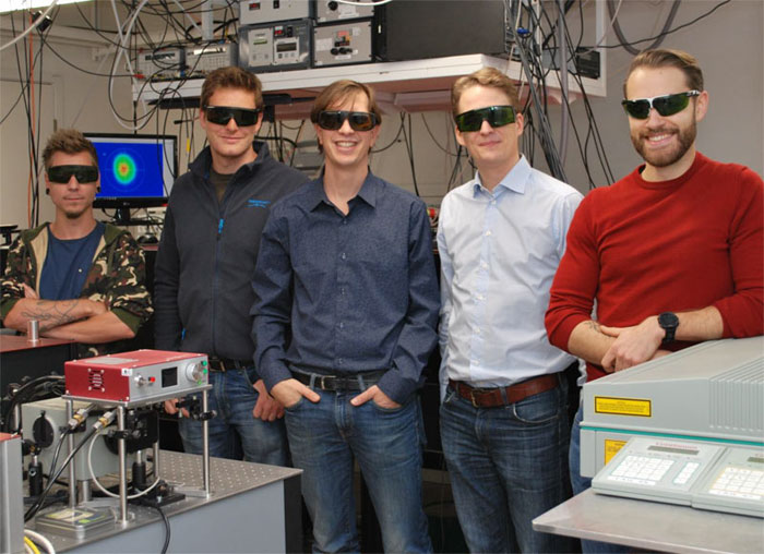 Researchers from Lund University developed an imaging method that provides an unprecedented view of sprays such as the ones used for liquid fuel combustion. Pictured (from the left) are doctoral student Kristoffer Svendsen, postdoctoral researcher Diego Guénot, group leader at the Division of Combustion Physics Edouard Berrocal, group leader at the Division of Atomic Physics Olle Lundh, and doctoral student Jonas Björklund Svensson. Courtesy of Edouard Berrocal, Lund University.