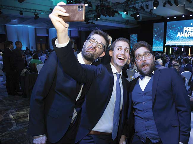 The Leica Geosystems team, two-time Prism Award winners and 2020 finalists, pose for a selfie before the ceremony. Courtesy of Joey Cobbs Photography.