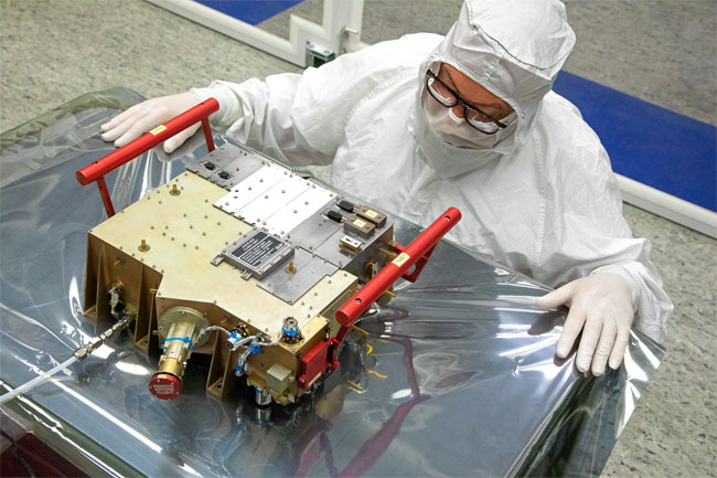 Southwest Research Institute's Norm Pelletier prepares the Ultraviolet Spectrograph (UVS) for delivery and integration onto the European Space Agency's JUICE spacecraft. As part of a 10-instrument payload to study Jupiter and its large moons, UVS will measure ultraviolet spectra that scientists will use to study the composition and structure of the atmospheres of these bodies and how they interact with Jupiter's massive magnetosphere. Courtesy of Southwest Research Institute.