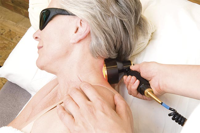 PBM treatment of neck pain. A typical session takes 10 minutes. Courtesy of THOR Photomedicine.